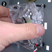 Fitting AFM02 antivibration ultra-soft fan mounts. Image 2 shows a clear low vibration fan (an AcoustiFan™ C-Series) being threaded from the inside of the PC onto fan mounts in position.